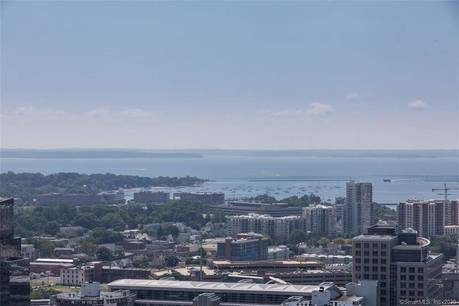 Condo Home Sold in Stamford CT 06901.  house near beach side waterfront with swimming pool.