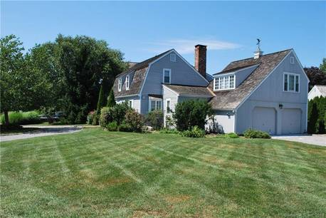 Single Family Home For Sale in Stamford CT 06902. Colonial house near waterfront with 2 car garage.