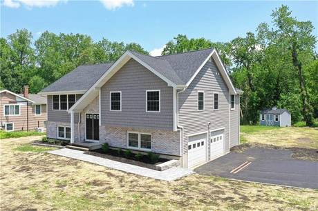 Single Family Home Sold in Danbury CT 06810. Ranch house near beach side waterfront with 2 car garage.