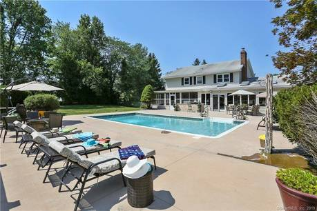 Single Family Home Sold in New Fairfield CT 06812. Colonial house near beach side waterfront with swimming pool and 2 car garage.
