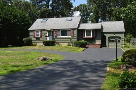 Single Family Home Sold in Norwalk CT 06854.  cape cod house near beach side waterfront with 1 car garage.