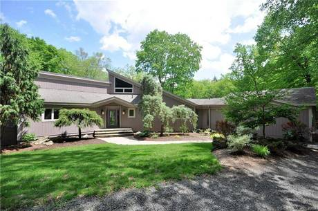 Single Family Home Sold in Newtown CT 06482. Contemporary house near river side waterfront with 2 car garage.