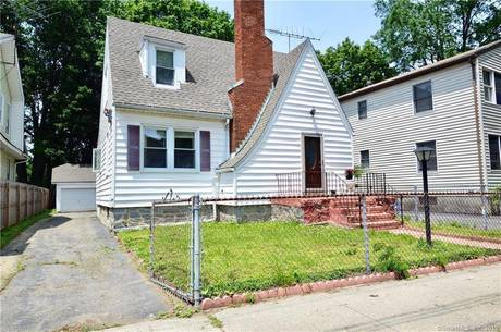 Single Family Home Sold in Bridgeport CT 06604. Old  cape cod house near beach side waterfront with 2 car garage.