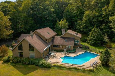 Single Family Home Sold in Bethel CT 06801. Contemporary, colonial house near waterfront with swimming pool and 2 car garage.