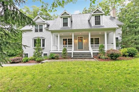Single Family Home Sold in Shelton CT 06484.  cape cod house near waterfront with 3 car garage.