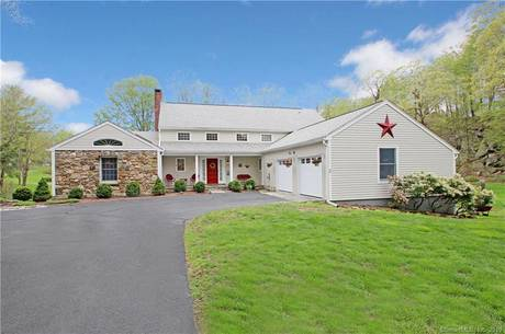 Single Family Home Sold in Ridgefield CT 06877.  cape cod house near lake side waterfront with swimming pool and 2 car garage.