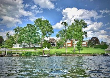 Single Family Home Sold in Brookfield CT 06804. Colonial house near lake side waterfront with 2 car garage.
