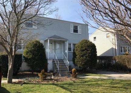 Multi Family Home Sold in Norwalk CT 06854.  house near waterfront with 4 car garage.