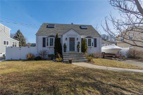 Single Family Home Sold in Fairfield CT 06824.  cape cod house near waterfront.