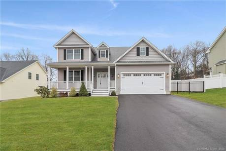 Single Family Home For Sale in Shelton CT 06484. Colonial house near waterfront with 2 car garage.