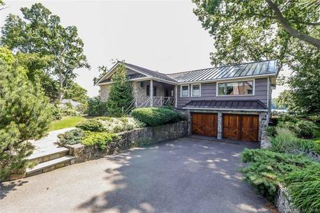 Single Family Home Sold in New Fairfield CT 06812. Ranch house near lake side waterfront with 2 car garage.