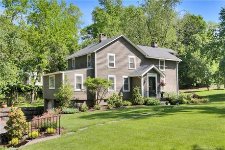 Single Family Home Sold in Westport CT 06880. Old colonial farm house near beach side waterfront with 2 car garage.