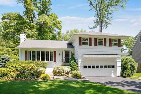 Single Family Home For Sale in Greenwich CT 06807.  house near waterfront with 2 car garage.
