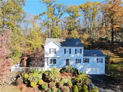 Single Family Home For Sale in New Fairfield CT 06812. Colonial house near waterfront with 2 car garage.
