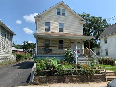 Multi Family Home Sold in Norwalk CT 06854. Old  house near waterfront with 2 car garage.