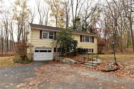Single Family Home Sold in Danbury CT 06810. Ranch house near waterfront with 4 car garage.