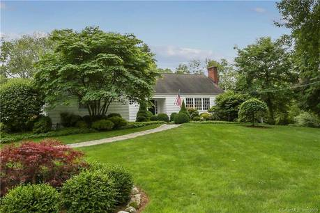Single Family Home Sold in Westport CT 06880.  cape cod house near beach side waterfront with 4 car garage.