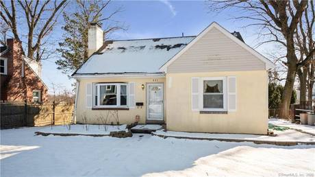 Single Family Home For Sale in Bridgeport CT 06606.  cape cod house near waterfront with 2 car garage.