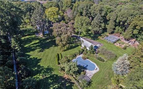 Single Family Home Sold in Wilton CT 06897. Old colonial house near waterfront with swimming pool and 1 car garage.
