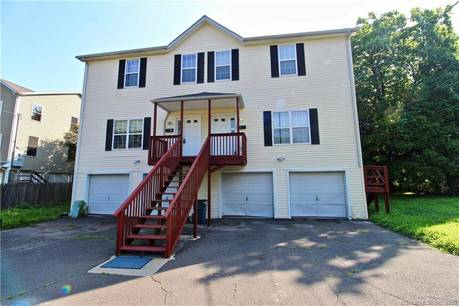 Condo Home Sold in Fairfield CT 06825.  townhouse near waterfront with 2 car garage.