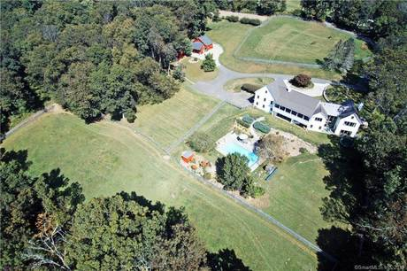 Single Family Home Sold in Redding CT 06896.  farm house near waterfront with swimming pool and 2 car garage.