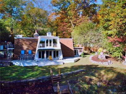Single Family Home Sold in Trumbull CT 06611. Ranch house near lake side waterfront with swimming pool and 2 car garage.