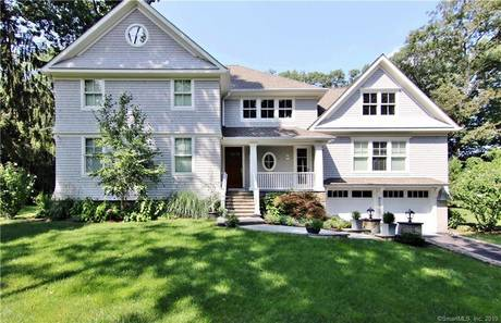 Single Family Home For Sale in Stamford CT 06905. Colonial house near waterfront with swimming pool and 2 car garage.