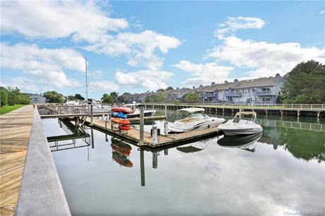 Condo Home Sold in Norwalk CT 06855.  townhouse near beach side waterfront with swimming pool and 1 car garage.