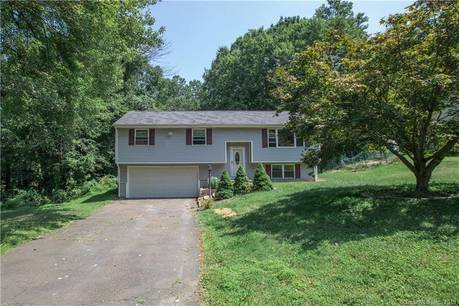 Single Family Home For Sale in Bethel CT 06801. Ranch house near waterfront with 2 car garage.