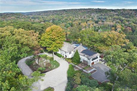 Single Family Home Sold in Weston CT 06883. Contemporary, mediterranean house near beach side waterfront with swimming pool and 3 car garage.