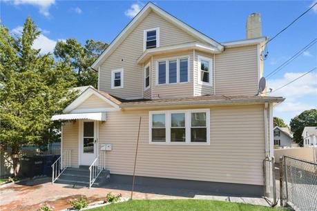 Multi Family Home Sold in Norwalk CT 06854. Old  house near waterfront with 4 car garage.