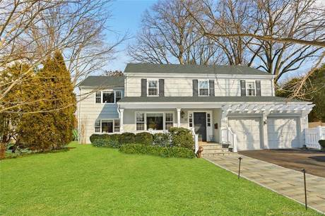 Single Family Home Sold in Greenwich CT 06870. Colonial house near beach side waterfront with 2 car garage.