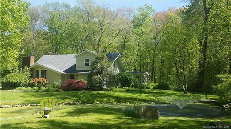 Single Family Home Sold in Wilton CT 06897.  cape cod house near lake side waterfront with 2 car garage.