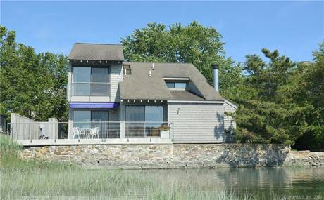 Single Family Home Sold in Norwalk CT 06853. Old contemporary house near beach side waterfront with 1 car garage.