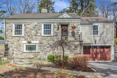 Single Family Home Sold in Stamford CT 06903.  cape cod house near river side waterfront with 1 car garage.