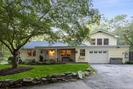 Single Family Home Sold in Stamford CT 06903. Ranch house near lake side waterfront with swimming pool and 1 car garage.