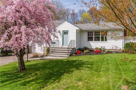Single Family Home Sold in Trumbull CT 06611.  house near waterfront with 1 car garage.