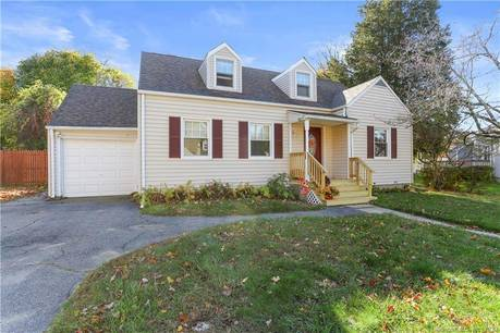 Single Family Home Sold in Bridgeport CT 06610.  cape cod house near beach side waterfront with 1 car garage.