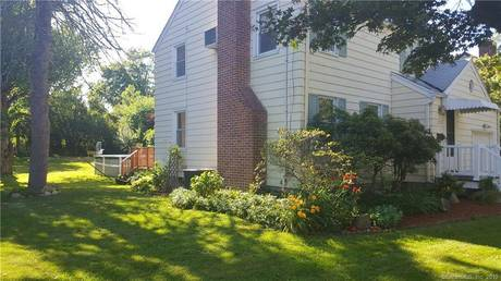 Single Family Home Sold in Stratford CT 06614. Colonial house near waterfront with swimming pool and 1 car garage.