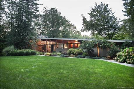 Single Family Home Sold in New Canaan CT 06840. Contemporary house near lake side waterfront with 2 car garage.