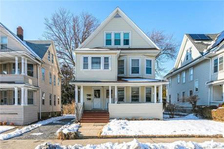 Multi Family Home Sold in Bridgeport CT 06605. Old  house near waterfront with 2 car garage.