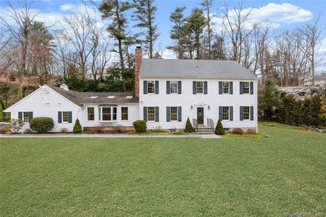 Single Family Home Sold in Greenwich CT 06830. Colonial house near waterfront with 2 car garage.