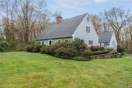 Single Family Home Sold in Redding CT 06896. Colonial cape cod house near waterfront with 2 car garage.