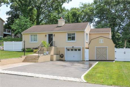 Single Family Home Sold in Trumbull CT 06611. Ranch house near waterfront with swimming pool and 1 car garage.