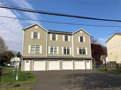Condo Home Sold in Fairfield CT 06825.  house near beach side waterfront with 3 car garage.