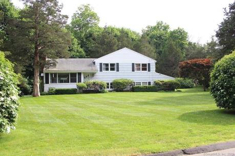 Single Family Home Sold in New Canaan CT 06840.  house near waterfront with swimming pool and 2 car garage.