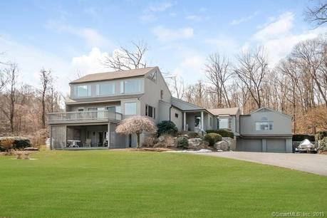 Single Family Home Sold in Wilton CT 06897. Contemporary house near waterfront with 3 car garage.