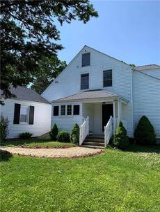 Single Family Home Sold in Bridgeport CT 06604.  cape cod house near waterfront with 1 car garage.
