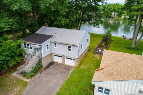 Single Family Home Sold in Bridgeport CT 06606. Ranch house near lake side waterfront with 2 car garage.