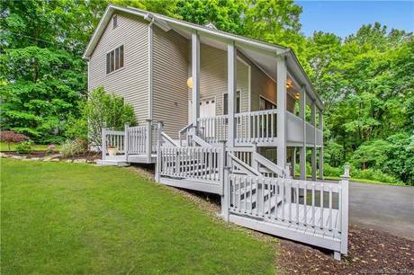 Single Family Home Sold in Bethel CT 06801. Contemporary cape cod house near waterfront with 2 car garage.